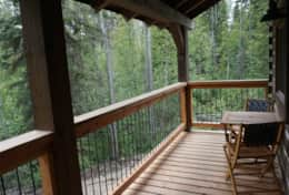 Enjoy a quiet conversation on the back elevated porch