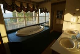 Master bath has whirlpool tub and rear view