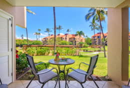 The lanai looks out into the center court where there are palms, beautiful plantings, BBQ pavailions