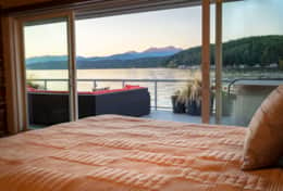 Vacation-Rental-hood-canal-resort-master-bedroom-view-walls-of-glass-beach-rental-alderbrook