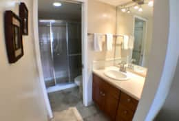 Master bathroom with shower and pocket door for privacy.  Bath towels provided.