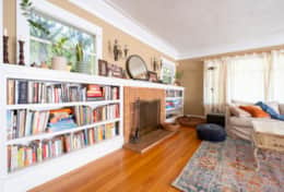 Spacious living Room with Smart TV, tons of books. Fireplace is decorative only.