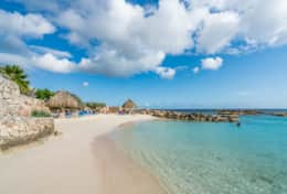 private sandy beach with palapa`s and sun beds