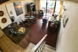 Kitchen, living room and dining area with air conditioning and lanai access