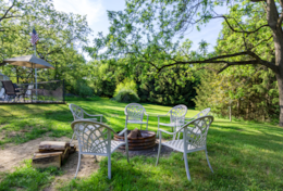 Relax by the fire pit after a dip in the hot tub.  1.5 acres means lots of room to play.