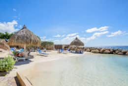 private beach with palapa´s