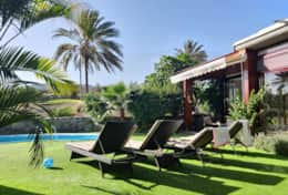 Private garden, heated pool with uninterrupted sea views over the golf course