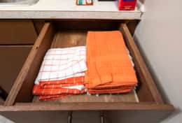 Extra napkins and towels, to keep the kitchen looking clean when people visit.