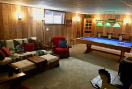 Great recroom with darts, pool table, and propane fireplace!