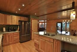 large kitchen fully equipped with two sinks and island