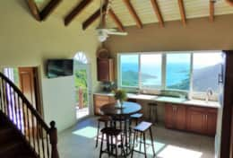 Fully equipped kitchen with views of Coral Bay and Norman Island