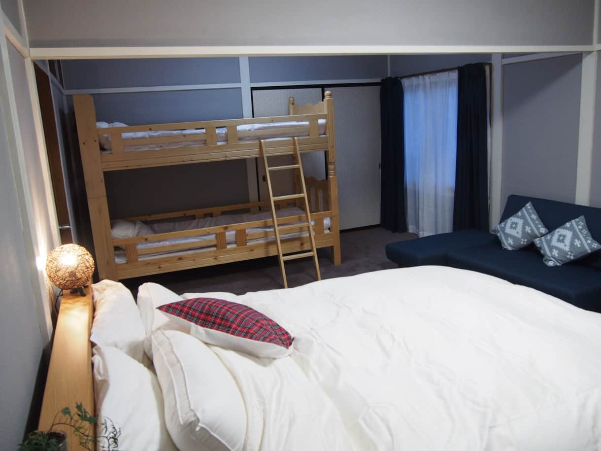 Room 4 is our Family Room, a queen for Mum and Dad, and bunks for the kids. Baby cribs are available