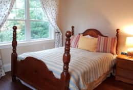 Main floor bedroom with queen bed.