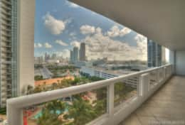 Furnished balcony views of Biscayne bay and downtown Miami