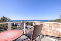 Relax and take in the ocean view in this private upper suite balcony.