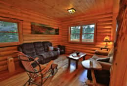 Wilmington Range Chalet living room with gas fireplace for cozy romantic Adirondack getaway