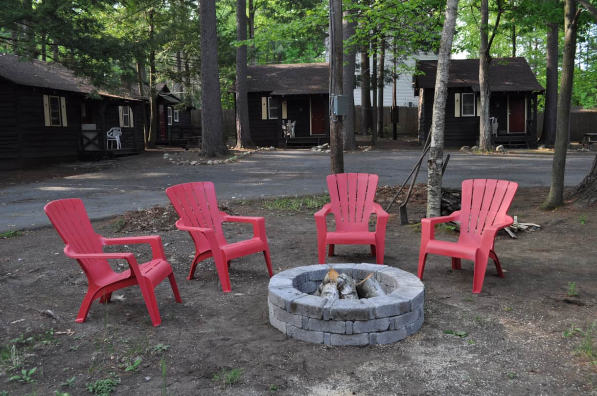 Enjoy a campfire at Pine Grove Cottages