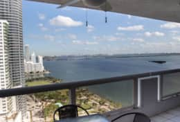 Fully furnished balcony with views of Biscayne Bay and park