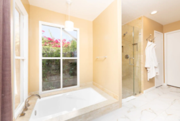 Master #2 Bath with oversized sunken tub, travertine shower and dual sinks