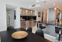 Dining area seating for 6, Kitchen counter seating for 2, Wet bar, fully equipped kitchen