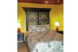 Bedroom gives you that tropical feel in style and comfort