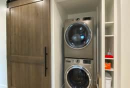 Hall barn door washer dryer main floor