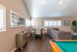 Entertainment room with snooker table for the grown ups and video game for the little ones