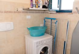 Clothes washer in family bath