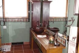 Upstairs Bath with Rustic Vessel Sink and Hand Carved Antique Vanity