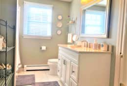 Bright guest bath with tub