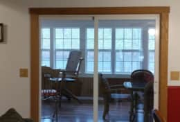 sliding doors from dining/living area to sunroom area