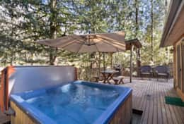 Large open deck with 5 person hot tub and table