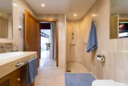Large bathrooms with large mirrors and marble finishing