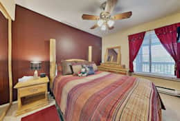 Master bedroom with comfortable queen bed