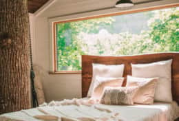 Queen bed with beautiful frame in the treehouse