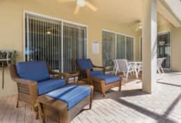 Relax and lounge in the screened in lanai and