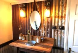 Rustic bathroom , made from timber recycled from shed demolished from behind farmhouse.