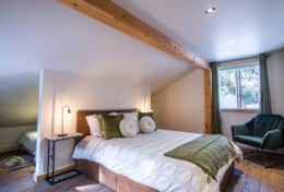 Bedroom 2 features a queen bed and 2 children's nooks with twin beds