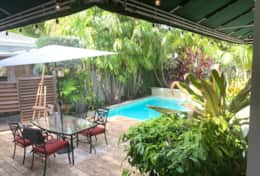 Backyard with outdoor dining & large heated pool