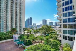 View of fully furnished balcony of downtown Miami and Biscayne Bay