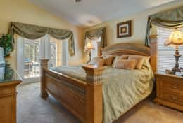 The master bedroom overlooking the pool