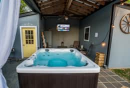 Hot tub with TV under pavilion
