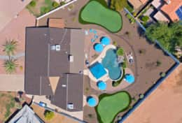 Aerial Footage of Pool, 2 Putting Greens, Pergola, and outdoor living areas
