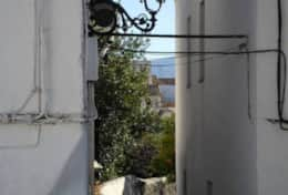 Typical Andalusian streets of a white village, Pinos del Valle.