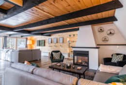 The chalet has 2 living spaces.  1 for watching TV and 1 for enjoying the gas fireplace.