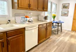 The large kitchen space has includes a breakfast nook for morning coffee