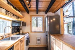Kitchen is equipped with stove, microwave, and refrigerator