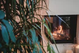 Corner fireplace with ample firewood provided complimentary for your stay