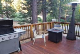 Deck with fire table, heat lamp, and BBQ - Get Lost Inn 2