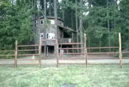 Tree House From the Meadow with Fence